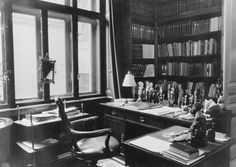 Sigmund Freud's writing desk in his office in Vienna as it looked in 1938 before his emigration to England when Germany annexed Austria. Description from fineartamerica.com. I searched for this on bing.com/images
