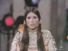 """Sacheen Littlefeather getting booed and then applauded at the Academy Awards in 1973. Marlon contacted AIM about providing a person to accept his Oscar for """"The Godfather"""" as a way to protest the ongoing siege at Wounded Knee, SD."""