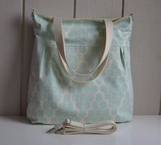 This is such a cute print!    Hive in Mint paired with a cream interior is so dreamy. This could be for a baby girl or boy. The fabric is a home