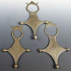 Antique Tuareg crosses. These thin silver crosses are probably at least 50 years old, and are quite beautiful. The four corners represent the four corners of the world, and were traditional gifts from