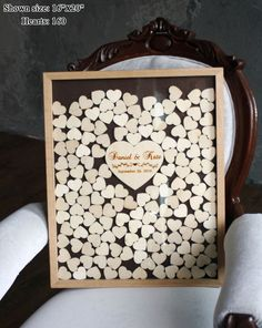 Besonderes Gästebuch mit Herzen aus Holz, Erinnerungen der Hochzeit / perfect wedding memories: guest book with wooden hearts in a frame made by Wooden Engraved Shop via DaWanda.com