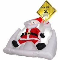 Animated Airblown Santa Making Snow Angel $139.99 This would be really cool for the roof yeah?