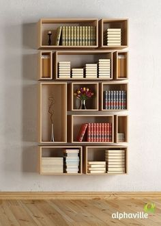 These hanging wooden box shelves make for a clean, organized, modern bookshelf look.