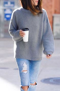 Lucy Whims keeps her street style casual in our gray Todd & Duncan cashmere boatneck sweater and a pair of light wash distressed jeans | Banana Republic