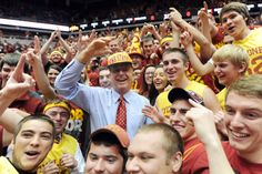 ESPN basketball commentator Dick Vitale cheers with Iowa State fans before the Iowa State and Michigan men's basketball game at Hilton Coliseum on Sunday, Nov. 17. Photo by Nirmalendu Majumdar/Ames Tribune