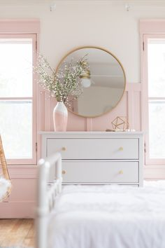 Pink and Gold Girls Bedroom. Gold Round Mirror Pink and Gold Bedroom. A beautiful Pink and Gold Girls Bedroom with a modern yet delicate touch, fun seating, and functional desk space perfect for all ages! Pink Bedroom Decor, Pink Gold Bedroom, Bedroom Mirrors, Bedroom Wallpaper, Master Bedrooms, Light Pink Nursery Walls, Pink And Gold Bedding, Light Pink Girls Bedroom, Girls Flower Bedroom