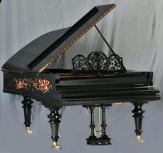 The music desk on this piano is very unique. It seems to resemble a delicate lace, which goes along well with the detailed painting design.  #grand #black