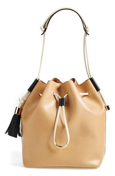 Vince Camuto 'Lorin' Drawstring Tote at Nordstrom.com. Contrasting tassel details further the smart vintage style of a lightly structured drawstring tote shaped from impeccably smooth leather.