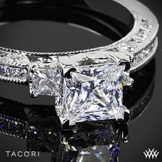 A trailblazing style on a classic princess-cut solitaire. Channel-set princess-cut diamonds give the ceiling of the band a streamlined look Tacori Classic Crescent Channel-Set Three Stone Engagement Ring