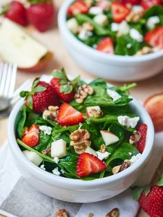 A simple spinach salad full of strawberries, apples, nuts, and goat cheese and smothered in a homemade tangy champagne vinaigrette!