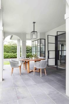 Beautiful modern large patio outdoor entertaining area in meticulously remodelled Spanish-style Melbourne home. Outdoor Dining, Outdoor Spaces, Maximalist Interior, Hamptons Style Homes, California Bungalow, Melbourne House, Luxury Pools, Spanish Style Homes, Australian Homes