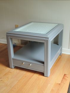 Gray and white end table with repurposed bottle caps and glass top