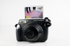 I Luv Polaroids, so I really want this instant camera! Looks fun to bring around town...