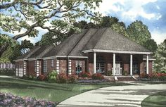 Steeped roof line and a stately porch bid you welcome to this graceful Southern style home.  House Plan # 151446.