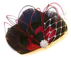 QUEEN of Hearts black and Red Peacock Feather Bridal Hair Fascinator Clip with Silver Netting. $23.00, via Etsy.