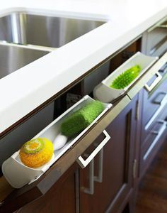 Great idea for wasted space in front of the kitchen sink - drawers for cloths, sponges and plug