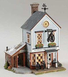 "Department 56 New England Village Series ""P.L. Wheeler's Bicycle Shop"" #56.56613"