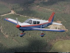 PA28-140 blue on bottom, white on top and red stipe highlight.