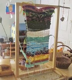 """Weaving on a classroom loom...I love collaborative art projects.  Kids can experiment and create together.  One idea is to leave this loom up and it can be an activity for the """"early finishers.""""  You can also take a finished piece off and display it, then start another...."""