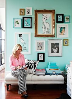 I love the teal in the illustrations and photography matching the teal wall. Effective. Love the selection of brown frames creating a harmony and focal point.