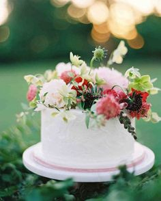 A Romantic, Flower-Filled Wedding in Oklahoma | Martha Stewart Weddings - The two smaller single-tier cakes, also by Amy Cakes, were simply iced and topped with fresh blooms.