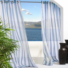 add a breezy cabana feel to your outdoor spaces - sheers available at @hayneedle