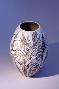 Eunice Botes Ceramics -white porcelain  dark grey sqraffito (etched lines)  and sprigs