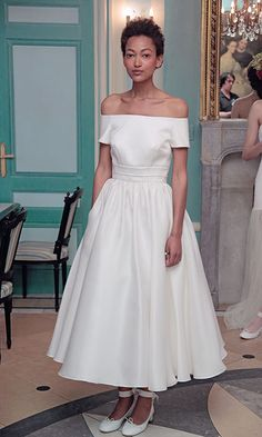 Designer Delphine Manivet channels a classic off-the-shoulder 1950's vibe to infuse your big day with old Hollywood glamour.