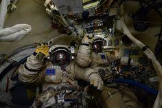 Cosmonauts Yuri Malenchenko and Sergey Volkov prepare for Wednesday's spacewalk. Credit: NASA/Scott Kelly
