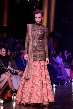 A line floral skirt and full sleeved top, a combo done back in the day. Revisited by Sabyasachi