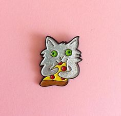 Have you seen the video of the cat hugging a slice of pizza? Go look it up, its adorable. Anyway, this pin is based on that cat, and the way it so perfectly summed up my feelings towards pizza: warmly embracing it in a death grip while staring off into the cosmos. This pin is 1.25 in size with a silver glitter and glossy enamel finish. One post on the back with a black rubber clutch.