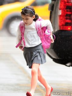 June 7, 2013: Katie Holmes pictured today dropping Her Daugther Suri Cruise off school in New York City on a rainy day.
