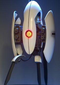 Portal Turret. with motion sensors that controls the light in the eye when you wave your hand in front of it and sound modules that plays in-game Turret activation, search, auto search, disabled and tipped over sounds and voice samples.