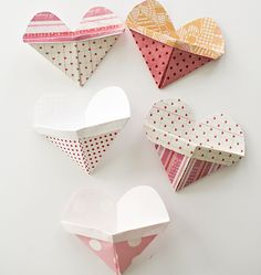 Origami Heart Pockets with Video. Make these cute origami heart envelopes with kids and watch the video to see how easy! Add a secret message inside or treat for Valentine favors.