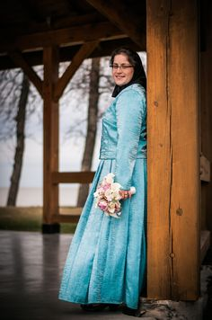 Hutterite wedding dress.  Our dresses are traditionally blue.  We do not wear white.  My dress had a fitted blouse, a long ankle length skirt, and has a fitted jacket.  This is one of 5 special homemade dresses made for my wedding.