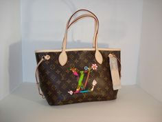4,499.00 This is a Louis Vuitton Murakami Neverfull Monogram bag in the original box with duster and shopping bag.This has never been worn and is in pristine original condition.