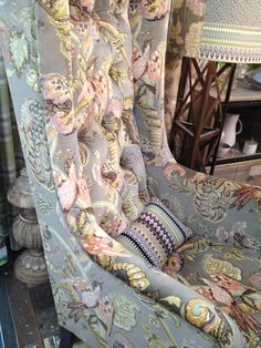 A chair dressed in Ian Sanderson fabric from the 'Poppinjay' collection