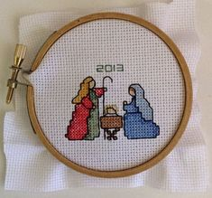 Counted cross stitch nativity stitched on 18 count white Aida fabric with cotton embroidery thread and gold kreinik filament thread. Still to be framed. Cross Stitch Christmas Stockings, Xmas Cross Stitch, Cross Stitch Fabric, Cross Stitch Love, Cross Stitch Cards, Cross Stitch Samplers, Cross Stitch Kits, Christmas Cross, Cross Stitching