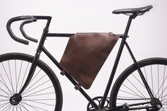 Brown Leather Cycling Bag by Lift Off: Stylish and secure, the design opens and closes with a zipper and is outfitted with blue cotton lining and interior pockets. Leather Bicycle, Bicycle Bag, Cowhide Leather, Brown Leather, Leather Bag, Course Vintage, Bike Leathers, Cycling Bag, Commuter Bag