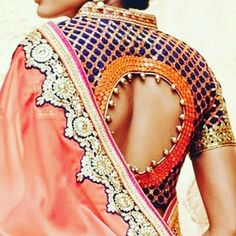 Can't stop staring at this #cutout #saree blouse. Double tap if you want to see more designs #sari #sariblouse #desibride #navy #orange #gold #wedding #asianbride #desi #indian