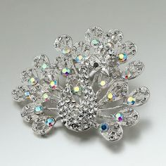 Pugster Peacock Clear Crystal Brooches And Pins Pugster. $15.49. One free elegant cushioned Gift box available with every order from Pugster.. Exquisitely detailed designer style with Swarovski cystal element.. Money-back Satisfaction Guarantee.. Occasion: casual wear,anniversary, bridal, cocktail party, wedding. Can be pinned on your gown or fastened in your hair with bobby pins.