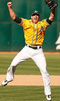 @Oakland Athletics reliever Grant Balfour celebrates after retiring Michael Young on a fly ball to center field for the game's final out. The A's capped their improbable run to the AL West title with a 12-5 thumping of the Rangers.