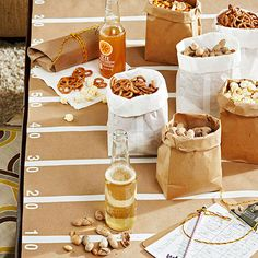Dress up your snack station with decorated kraft paper! More football part ideas: http://www.bhg.com/party/birthday/themes/throw-a-football-party/?socsrc=bhgpin090813partysnackstation#page=6