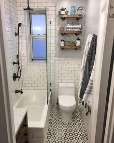 Farmhouse bathroom, black and white bathroom, patterned tiles Gorgeous classic farmhouse bath. Keeping this small space light and bright with classic subway, patterned cement tiles and rustic wood accents. Wood Bathroom, Bathroom Layout, Bathroom Interior, Bathroom Black, Bathroom Ideas, Master Bathroom, Bathroom Carpet, Bathroom Hardware, Bath Ideas