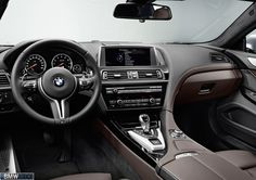 love that swoop from the passenger side all the way down the middle console.  and black and brown is always beautiful - BMW M6 Gran Coupe
