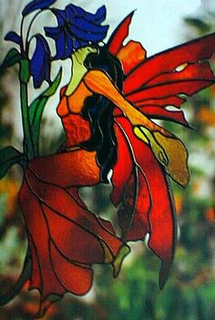 I have this pattern...should make it someday. Stained glass fairy