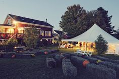 A Beautiful Fall Wedding - The hay bales for outdoor seating (and the vows) and the tent reception is exactly what we have in mind.