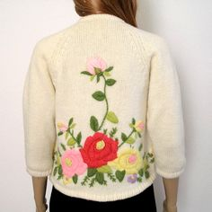 RESERVED RESERVED PLEASE DO NOT PURCHASE UNLESS YOU ARE TERRY! 1950s 1960s Sweater Cardigan Crewel Embroidered ROSES on Creamy White. Need a touch of Spring? This beautiful late 50, possibly early 60s, cardigan sweater is covered in roses and flowers of pale pink, rose pink, lavender, yellow, and deep, rosy red, with moss green and dark green leaves and vines. The top rosebuds are 3D puffy. - No maker, size, or content tags, but would best fit a modern Small to Medium. - Knit feels like o...