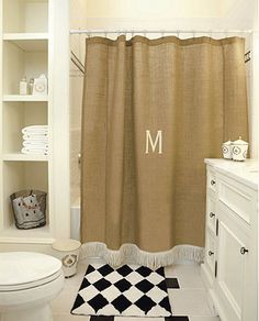 Burlap Shower Curtain. For more ideas on decorating with burlap, go to http://decoratingfiles.com/2012/08/15-ways-to-decorate-with-burlap/