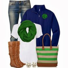 Stylish green scarf, blue sweater, jeans, long boots and handbag combination for fall